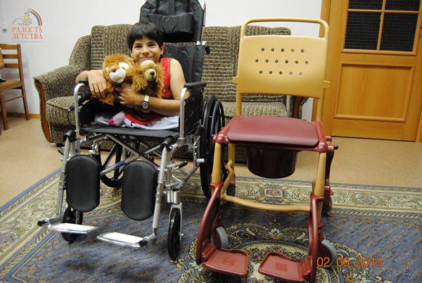 minРыжкович Оксана фото с коляской (1)
